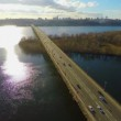 Bright sunny day in big city, transport bridge across river — Stock Video #69324905