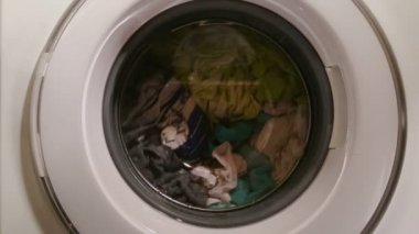 Washing machine full of clothes, home appliance, laundromat — Stock Video