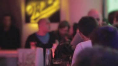 Many people chatting at bar, barman serving drinks at nightclub — Stock Video