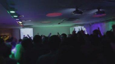 Crowd moving in ecstasy, enjoying music at nightclub, silhouette — Stock Video