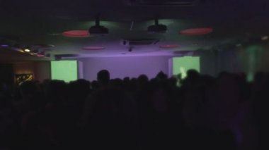 Excited crowd partying at club, light effects on background — Stock Video