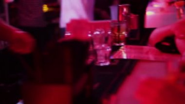 Barman working, pouring, serving alcohol drinks to bar guests — Stock Video