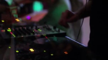 DJ working at club, silhouette, club atmosphere, creative video — Stock Video