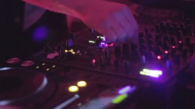 Disk jockey club performing, hands turning, switching controls — Stock Video