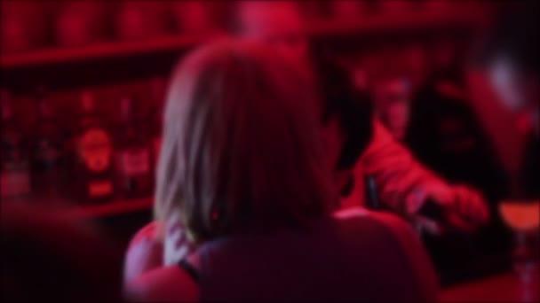 Drunk passionate lesbian blond, brunette kissing at nightclub — Vídeo de stock