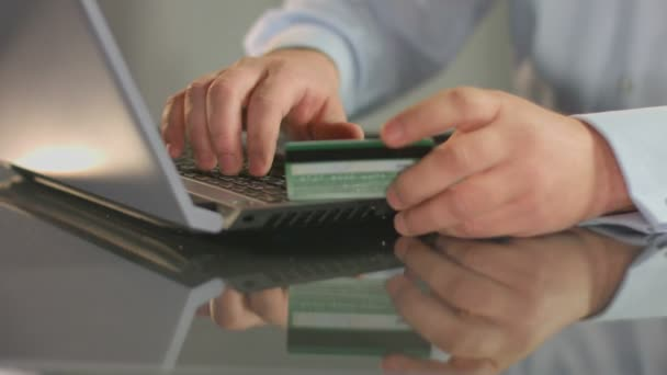 Businessman inserting credit card number, online banking service — Vidéo