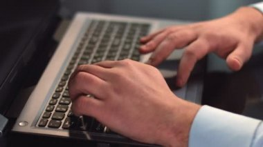Male office employee typing, working on laptop, using touchpad — Stock Video