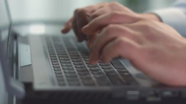 Closeup of male hands typing, using touchpad, working on PC — Vídeo de stock