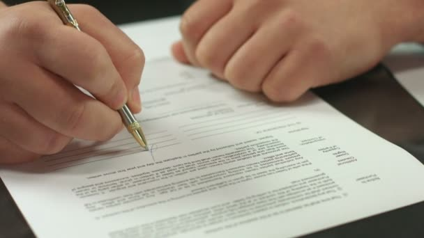 Male hand signing pages of contract, work with official document — Vídeo de stock