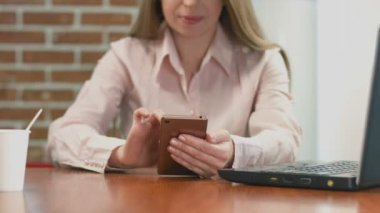 Happy female freelancer working on smart phone, watching video — Stock Video