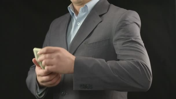Man business suit hiding dollars in pocket, money saving, income — Vidéo