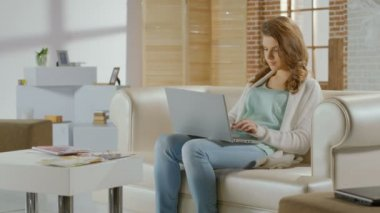 Pretty female chatting in social networks on laptop, having rest — Stock Video