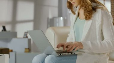 Female blogger typing actively on laptop, woman working at home — Stock Video