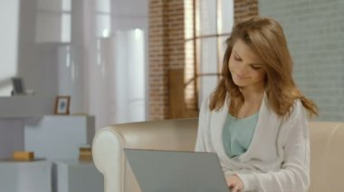 Happy casual girl busy, working on project using laptop at home — Stock Video
