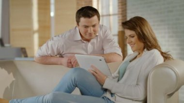 Happy young couple watching family photos on tablet PC, memories — Stock Video