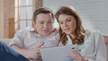 Smiling wife husband shopping online, choosing items on tablet — Stock Video