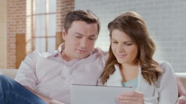Happy man woman enjoying time together, online shopping, tablet — Stock Video