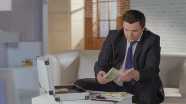 Overjoyed businessman grabs money from briefcase, success, greed — Stock Video