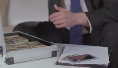 Rich guy takes dollars from briefcase, money obsession, greed — Stock Video