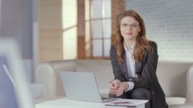 Beautiful businesswoman, office worker smiles pretty for camera — Stock Video