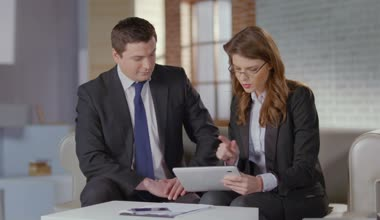 Female employee showing financial charts, presentation to boss — Stock Video
