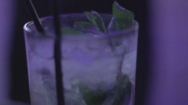 Glass of mojito, refreshing cocktail, lime, mint, ice, thirsty — Stock Video