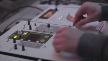 Male hands mixing sounds, turning controls, professional DJ deck — Stock Video