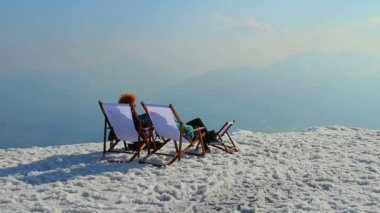 Rich couple enjoying view from top of snowy mountain, relaxation — Vidéo