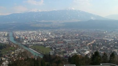 Aerial view of big city, river, Austrian Alps, mountain ridge — Stock Video