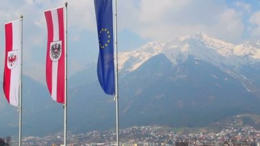 Flags with EU, Austria, Tyrol signs, majestic Alps on background — Stock Video