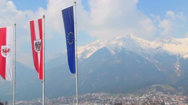 Flags with EU, Austria, Tyrol emblems waving in air, mountains — Stock Video