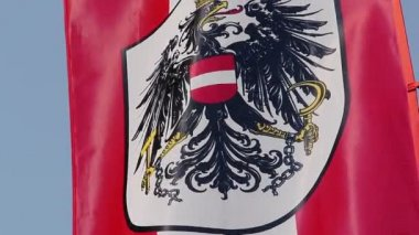 Austrian flag with coat of arms, national emblem waving in sky — Stock Video