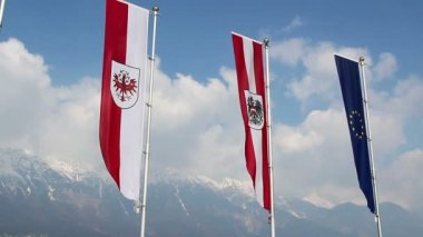 EU, Austrian, Tyrol flags wave, popular European mountain resort — Stock Video