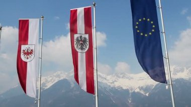 Tyrol, Austrian, EU flags waving, grand snowy Alps on background — Stock Video