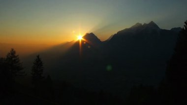Amazing sunset, sun slowly hiding behind mountain time-lapse — Stock Video