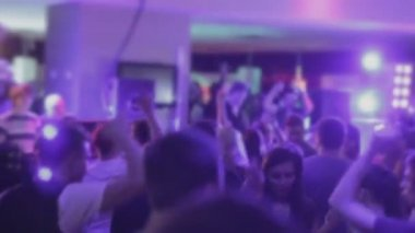 Gathering of people waving hands, relaxing at nightclub party — Stok video