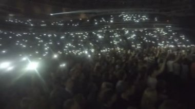 Crowd of fans waving phones in darkness. Lights sparkle during popular slow song — Stock Video