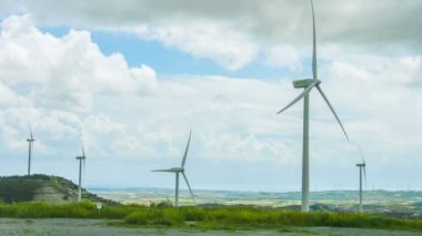 Windmill propellers spinning. Green energy generation. Clouds in stormy sky — Stock Video