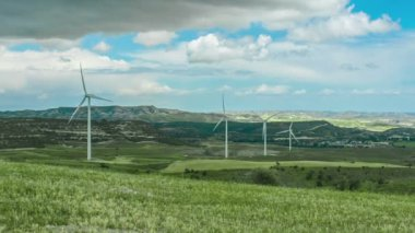 Beautiful green field with wind turbines rotating. Renewable energy source — Stock Video