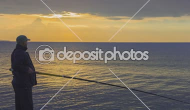 Man fishing at sunrise, enjoying hobby, spending his leisure time with pleasure — Stock Video