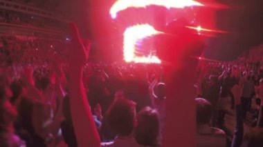 Close-up of hands showing thumbs up during concert. Crowd enjoying celebration — Stock Video