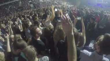 Minsk, Belarus - April 15, 2015. Robbie Williams concert at Minsk Arena. Crowd of young guys filming performance on smartphones. Security guard at work — Stock Video