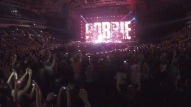 Minsk, Belarus - April 15, 2015. Robbie Williams concert at Minsk Arena. Fans jumping wildly in ecstasy, enjoying performance. Robbie Williams singing — Stock Video