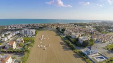 Top view of popular resort town at seaside in Cyprus. Aerial shot with drone — Stock Video