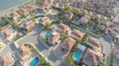 Top view of houses with swimming pools for rent. Vacation at resort. Aerial — Stock Video