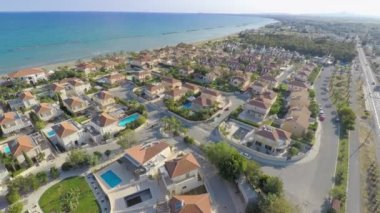 Aerial shot of luxury cottages along coastline. Top view of beautiful seascape — Stock Video