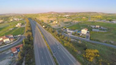 Modern transport infrastructure. Top view of road, fields, rural area. Aerial — Vidéo