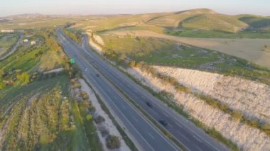 Car travel on vacation. Aerial shot of amazing green landscape, road traffic — Stock Video