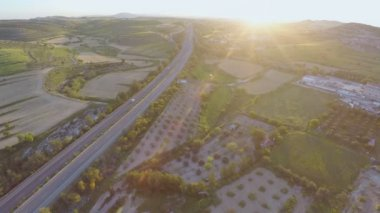 Aerial shot of modern interstate highway. Top view of fantastic green landscape — Stock Video