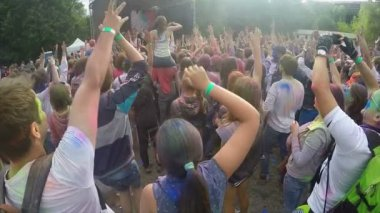 Mass of positive people raising hands up, slow motion, enjoying fest atmosphere — Stock Video
